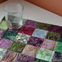 Purple and green batik square table runner